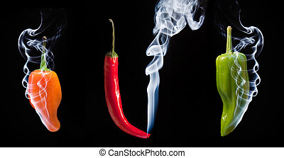 Smoke comes out of tips of hot chilli peppers in orange red and green