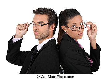 Serious and successful businesspeople on white background
