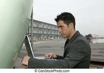 Man in suit with laptop computer