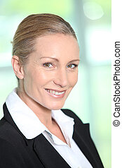 Profile view of blond businesswoman