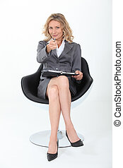 Woman with a personal organizer in a swivel chair