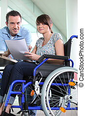 Disabled female office worked with colleague