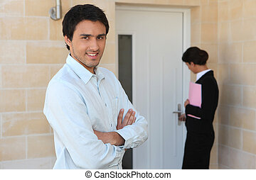 Estate agent showing man around property