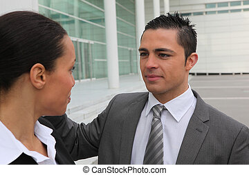 Young couple outside an office building