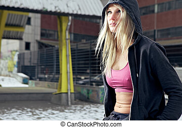 Determined fitness woman - Portrait shot of young determined...