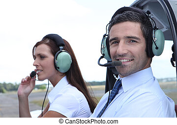 Smiling man waiting for takeoff in the cockpit of a light aircraft