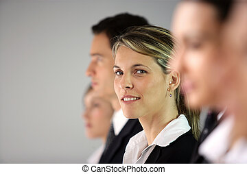 Businesswoman standing in a row
