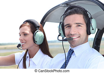 Man and woman in the cockpit of a light aircraft waiting for takeoff