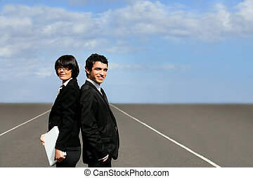Business partners stood on runway