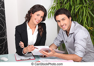 Businesswoman discussing a contract with her client
