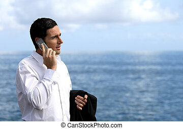 Man talking on his mobile phone on the quay