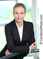 Smiling woman in a suit
