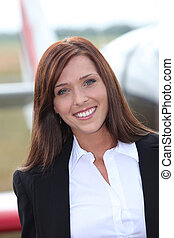 Woman in front of airplane