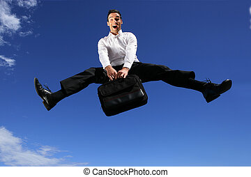 Ecstatic businessman jumping with briefcase