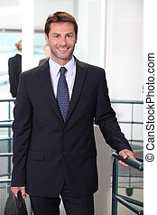 Business man standing in office