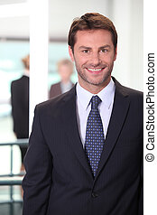 Smiling business man standing