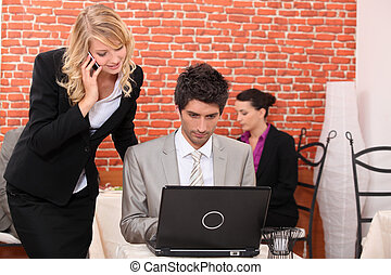 Man and woman looking at a laptop computer