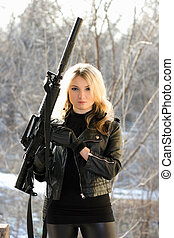 young blonde with a gun