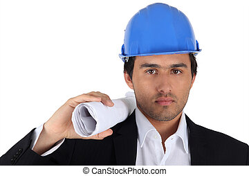 Architect with plan and hardhat