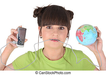 Brunette holding mp3 player and miniature globe