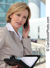 Businesswoman booking an appointment