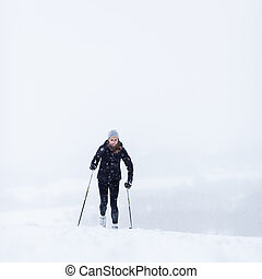 Cross-country skiing - Cross-country skiing: young woman...
