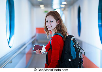 young woman boarding an aircraft - Portrait of a young woman...