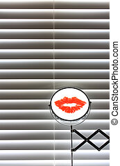 Bathroom blinds with shaving mirror and lipstick mark