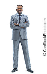 Full length portrait of a happy businessman standing against...