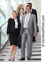 Business people walking down steps