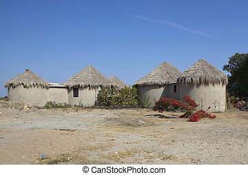 cottages in gujarat - thatched cottages in a dry arid...
