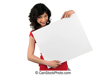 Brunette woman behind the white panel