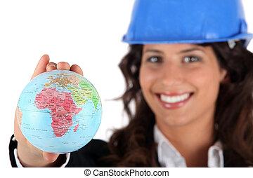 Female architect holding miniature globe