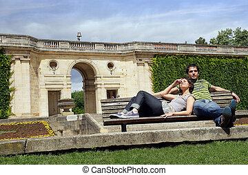 Couple sat on park steps