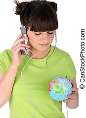 Girl with her phone plugged into the world