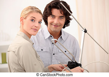 Couple with a television antenna