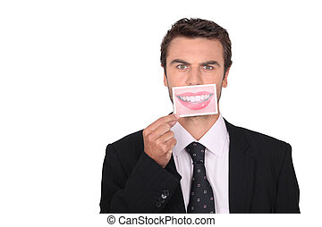 Businessman holding a photograph of a woman's mouth in place of his