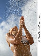 Woman splashing in the sea