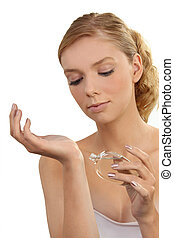 dainty young blonde putting on perfume