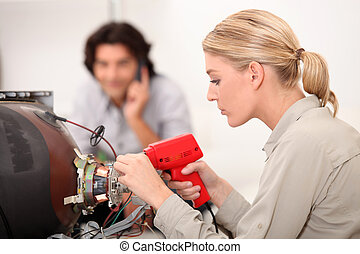 TV repair woman with a soldering gun