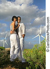 Couple in front of wind farm