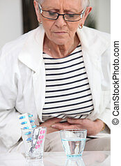 Woman about to take pain relievers