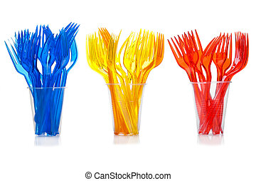 Disposable tableware. Set of colored plastic forks in...