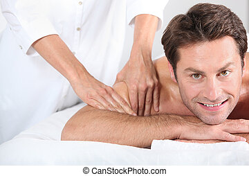 Man being given a massage.