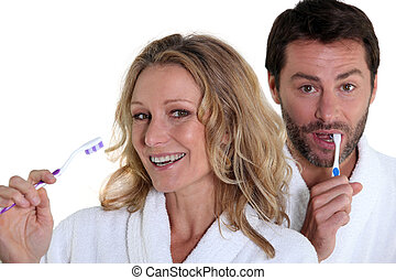 man and woman with toothbrush