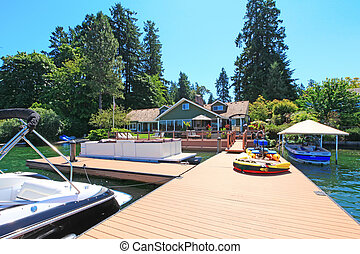 Beautiful lake waterfront property with dock and very large deck.