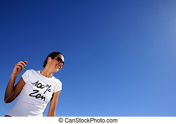 Woman listening to music in the sun