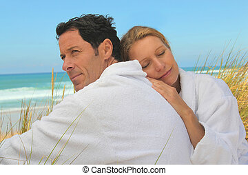 Couple relaxing on the beach