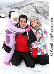 Young family on a snowy mountain