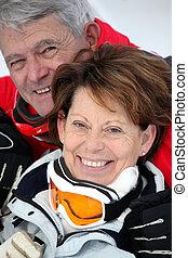 Elderly couple skiing
